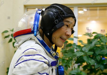 Space flight participant Yusaku Maezawa attends a training session ahead of the expedition to the International Space Station at the Gagarin Cosmonauts' Training Center in Star City outside Moscow, Russia, . A Japanese fashion tycoon who's booked a SpaceX ride to the moon is going to try out the International Space Station first. Yusaku Maezawa announced that he's bought two seats on a Russian Soyuz capsule. He'll blast off in December on the 12-day mission with his production assistant and a professional cosmonaut
