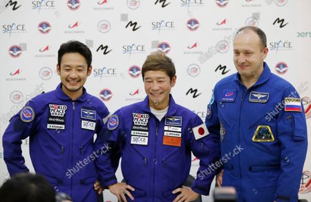 Roscosmos cosmonaut Alexander Misurkin, right, space flight participants Yusaku Maezawa, center, and Yozo Hirano attend a news conference ahead of the expedition to the International Space Station at the Gagarin Cosmonauts' Training Center in Star City outside Moscow, Russia, . A Japanese fashion tycoon who's booked a SpaceX ride to the moon is going to try out the International Space Station first. Yusaku Maezawa announced that he's bought two seats on a Russian Soyuz capsule. He'll blast off in December on the 12-day mission with his production assistant and a professional cosmonaut