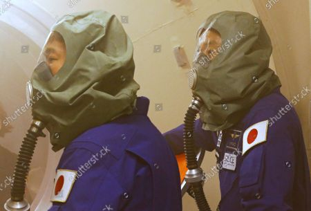 Space flight participants Yusaku Maezawa (L) and Yozo Hirano attend a training ahead of the expedition to the International Space Station, in Star City, Russia, 14 October 2021. Japanese entrepreneur Yusaku Maezawa and his production assistant Yozo Hirano, led by Roscosmos cosmonaut Alexander Misurkin, will take part in a mission to the International Space Station (ISS) scheduled for 08 December 2021.