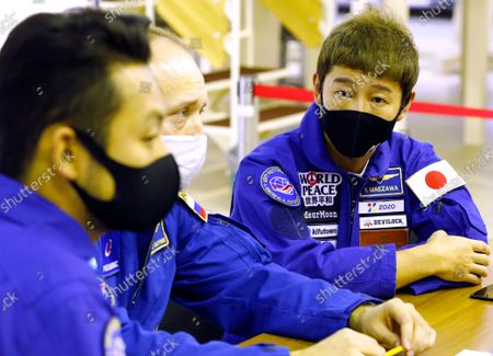 Stock Image of Space flight participants Yusaku Maezawa (R) and Yozo Hirano (L) and Roscosmos cosmonaut Alexander Misurkin (C) attend a training ahead of the expedition to the International Space Station, in Star City, Russia, 14 October 2021. Japanese entrepreneur Yusaku Maezawa and his production assistant Yozo Hirano, led by Roscosmos cosmonaut Alexander Misurkin, will take part in a mission to the International Space Station (ISS) scheduled for 08 December 2021.