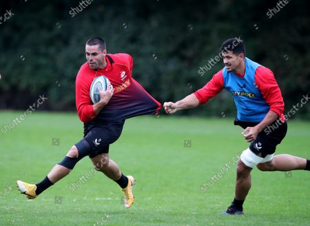Sean Maitland is held by Theo McFarland.