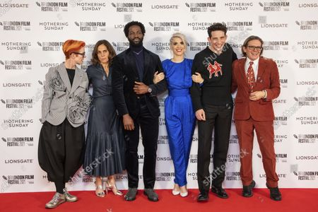 Sandy Powell, from left, Elizabeth Karlsen, Sope Dirisu, Director Eva Husson, Josh O'Connor and Stephen Woolley pose for photographers upon arrival at the premiere of the film 'Mothering Sunday' during the 2021 BFI London Film Festival in London