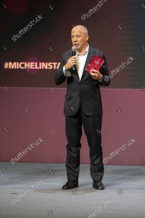 Stock Photo of Restaurateur Arkady Novikov hold a trophy for Artem Efstafiev, chef of the Artest-Chief's Table restaurant, who received two Michelin star during the award ceremony, which took place in the concert hall of Zaryadye Park in Moscow, Russia, . French gastronomic bible the Michelin Guide awarded nine of its coveted stars to restaurants in Moscow on Thursday as it unveiled its first lineup of recommendations in the Russian capital. Representatives of the guide - considered the international standard of restaurant rankings - released the first Moscow edition of their iconic red book at a ceremony at Moscow
