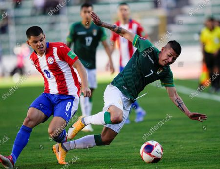 Bolivia's Juan Carlos Arce (R) in action against Paraguay's Richard Sanchez, during a soccer match between Bolivia and Paraguay amid the South American qualifers to Qatar 2022 World Cup, at the Hernando Siles Stadium in La Paz, Bolivia, 14 October 2021.