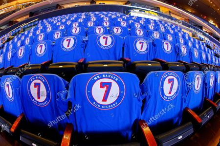 Stock Photo of In this image taken with a fisheye lens, T-shirts with New York Rangers great Rod Gilbert cover the seats for fans before opening night NHL hockey game between the Rangers and the Dallas Stars, in New York