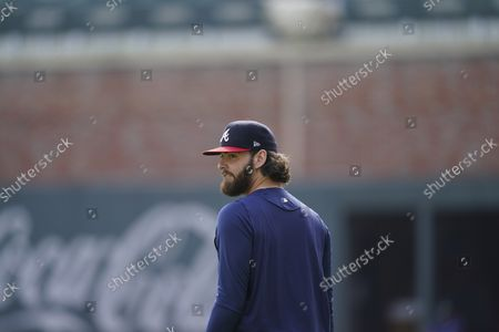 Atlanta Braves starting pitcher Ian Anderson (36) looks on during a workout ahead of the NLCS playoff baseball game, in Atlanta