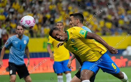 Brazil's Alex Sandro heads the ball during a qualifying soccer match for the FIFA World Cup Qatar 2022 against Uruguay at Arena da Amazonia in Manaus, Brazil, Thursday, Oct.14, 2021