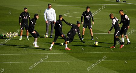 PSG's forward Kylian Mbappe (C) practices with teammates (L to R) Marco Verratti, Mauro Icardi, Archraf Hakimi, Ander Herrera, Rafinha and Thilo Kehrer during a training session at the Camp des Loges Paris Saint-Germain football club's training center in Saint-Germain-en-Laye, FRANCE - 14/10/2021