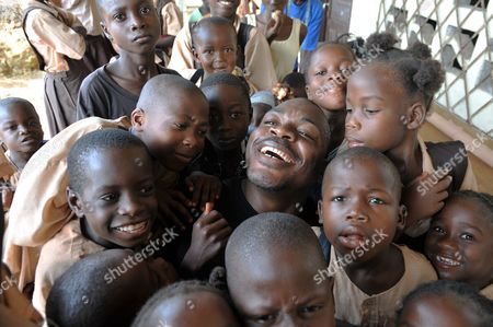 Joshua Milton Blahyi with local children