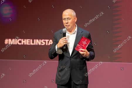 Restaurateur Arkady Novikov shows a trophy of Artem Efstafiev, chef of the Artest-Chief's Table restaurant, who received two Michelin star during the award ceremony, which took place in the concert hall of Zaryadye Park in Moscow, Russia, . French gastronomic bible the Michelin Guide awarded nine of its coveted stars to restaurants in Moscow on Thursday as it unveiled its first lineup of recommendations in the Russian capital. Representatives of the guide - considered the international standard of restaurant rankings - released the first Moscow edition of their iconic red book at a ceremony at Moscow