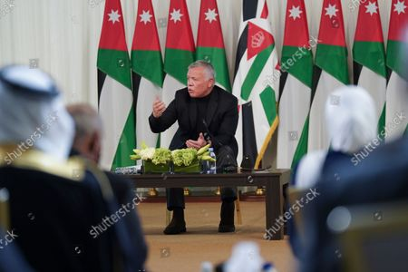 Jordan's King Abdullah II speaks during a meeting with tribal leader in Al-Qasta, south of Amman, Jordan. A years-long economic downturn, accelerated by the coronavirus pandemic, means more than half of young Jordanians are now unemployed and the country is sinking deeper into debt. Recent revelations that King Abdullah II secretly amassed more than $106 million in luxury properties abroad have further undermined public trust