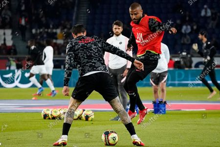 (R-L) Rafinha of PSG and Mauro Icardi of PSG warm up before the match
