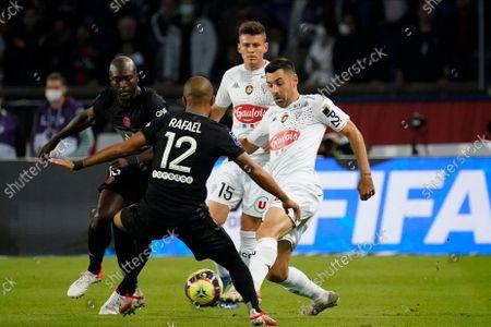 Thomas Mangani of Angers takes on Rafinha of PSG