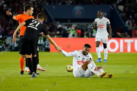 Sofiane Boufal of Angers is fouled by Ander Herrera of PSG