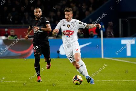 Pierrick Capelle of Angers takes on Rafinha of PSG