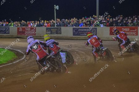 Steve Worrall  (White) and Charles Wright  (Yellow) chase Chris Harris  (Red) and Jordan Palin  (Blue) during the SGB Premiership Grand Final 2nd leg between Peterborough and Belle Vue Aces at East of England Showground, Peterborough on Thursday 14th October 2021.