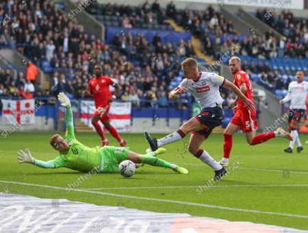 Wigan Athletic goalkeeper Ben Amos saves from Eoin Doyle of Bolton Wanderers