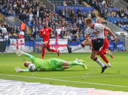 Stock Photo of Wigan Athletic goalkeeper Ben Amos saves from Eoin Doyle of Bolton Wanderers