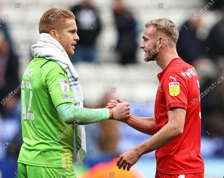 Wigan Athletic goalkeeper Ben Amos celebrates at full time with Jack Whatmough
