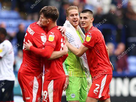 Wigan Athletic goalkeeper Ben Amos celebrates at full time with Kelland Watts