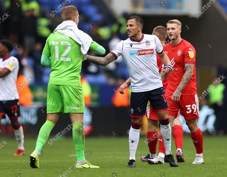Stock Image of Wigan Athletic goalkeeper Ben Amos with Antoni Sarcevic of Bolton Wanderers at full time