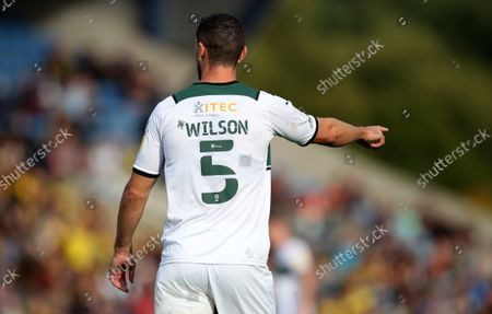 The Mind Charity EFL numbers and lettering on the back of the shirt of James Wilson of Plymouth Argyle