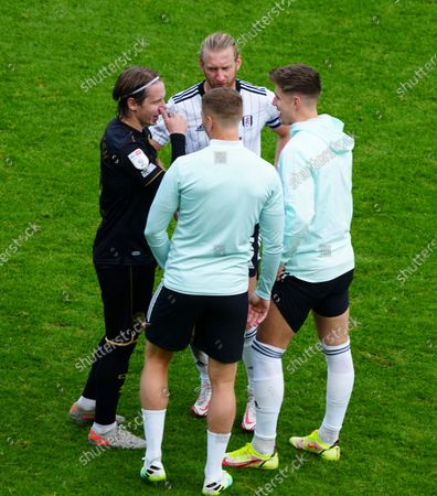 Stefan Johansen of QPR chats to Tim Ream, Tom Cairney and Alfie Mawson of Fulham at full time