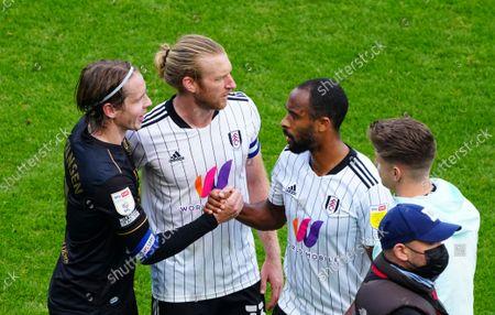 Stefan Johansen of QPR and Denis Odoi of Fulham shake hands at full time