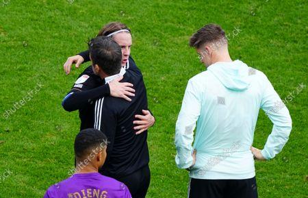 Stefan Johansen of QPR hugs Fulham Manager Marco Silva at full time