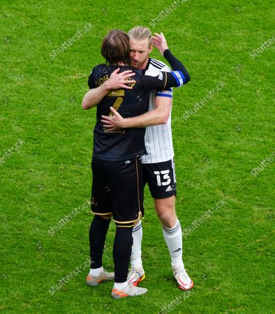 Stefan Johansen of QPR and Tim Ream of Fulham hug at full time