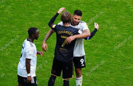 Stefan Johansen of QPR and Aleksandar Mitrovic of Fulham hug at full time