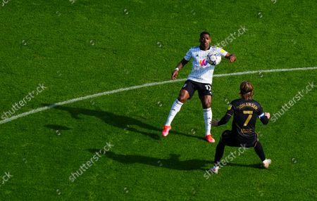 Ivan Cavaleiro of Fulham and Stefan Johansen of QPR