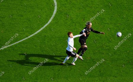 Harrison Reed of Fulham battles with Stefan Johansen of QPR