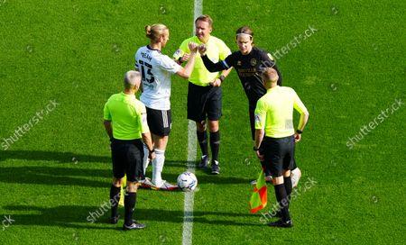 Tim Ream of Fulham and Stefan Johansen of QPR bumps fists after the coin toss