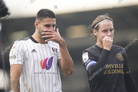 Former team mates Aleksander Mitrovic of Fulham and Stefan Johansen of QPR  walks off the pitch together