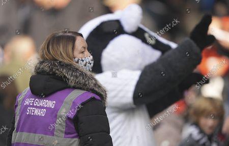 Safe guarding steward Rosie O'Sullivan with Billy the Badger