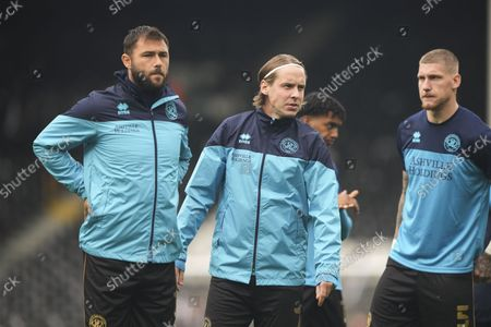 Former Fulham player, Stefan Johansen of QPR, with Charlie Austin and Jordy de Wijs during the warm up