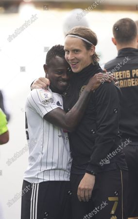Stefan Johansen of QPR says hello to former Fulham team mates, including Jean Michael Seri of Fulham in the tunnel before the match