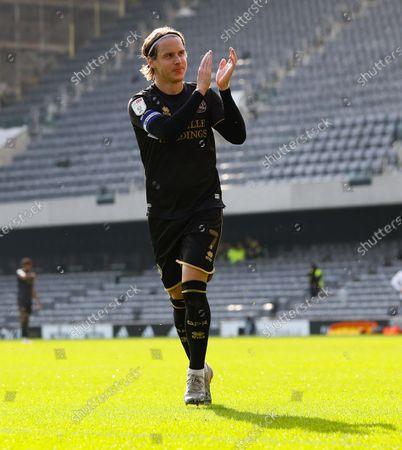 Stock Photo of Stefan Johansen (Captain) of QPR  applauds his old clubs fans