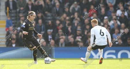 Stefan Johansen (Captain) of QPR  takes on Harrison Reed of Fulham