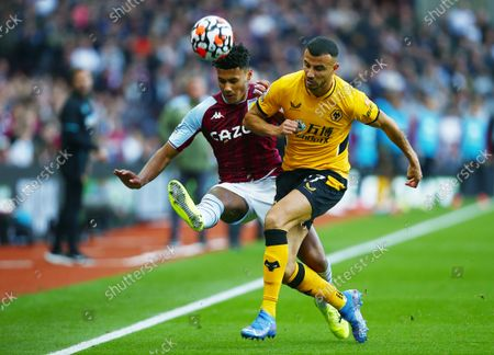 Ollie Watkins of Aston Villa and Romain Saiss of Wolverhampton Wanderers