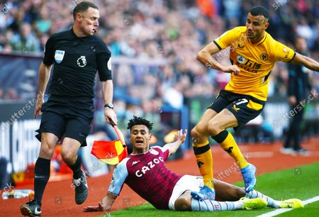 Romain Saiss of Wolverhampton Wanderers appears to stand on Ollie Watkins of Aston Villa