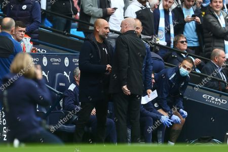 Pep Guardiola, manager of Manchester City greets Manager of Burnley, Sean Dyche