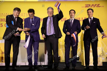 Stock Image of (GaD): Augustin de Romanet CEO of ADP, Marc Houalla Deputy CEO of ADP Director of Paris CDG Airport, John Pearson CEO of DHL Express, Jean-Baptiste Djebbari-Bonnet Minister Delegate for Transport and Philippe Pretat CEO of DHL Express France. Inauguration of the platform (HUB) of DHL Express in Paris-Charles de Gaulle in the presence of Jean-Baptiste Djebbari-Bonnet Minister Delegate for Transport, John Pearson CEO of DHL Express and Philippe Pretat CEO of DHL Express France. Paris, France