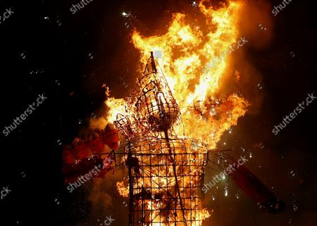 An effigy of demon king Ravana goes up in flames marking the end of Dussehra festival in Hyderabad, India, . Dussehra commemorates the triumph of Lord Rama over the demon king Ravana, marking the victory of good over evil