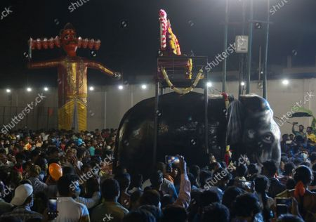 An effigy of demon king Ravana stands before going up in flames marking the end of Dussehra festival in Hyderabad, India, . Dussehra commemorates the triumph of Lord Rama over the demon king Ravana, marking the victory of good over evil