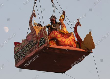 An Indian artist dressed as demon king Ravana performs in the 'Lord Rama's annual traditional play called Ramleela during the Dussehra festival celebrations in New Delhi, India, 15 October 2021. Limited people were allowed inside the Dussehra festival celebration area due to Indian government guidelines over the Covid-19 pandemic. Dussehra is an annual Hindu religious festival, which follows the nine-day festival of Navratri and marks the victory of the Hindu God Lord Rama over the evil demon king Ravana.