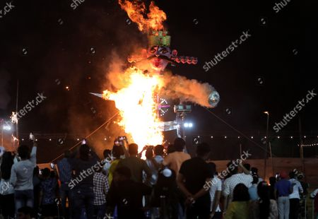 An effigy of demon king Ravana burns during the Dussehra festival celebrations in New Delhi, India, 15 October 2021. Limited people were allowed inside the Dussehra festival celebration area due to Indian government guidelines over the Covid-19 pandemic. Dussehra is an annual Hindu religious festival, which follows the nine-day festival of Navratri and marks the victory of the Hindu God Lord Rama over the evil demon king Ravana.