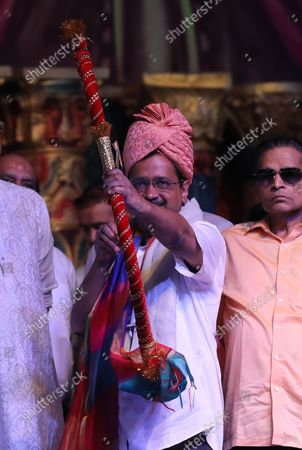 Delhi Chief Minister Arvind Kejriwal (C) poses with a bow and arrow, known to be Hindu god Lord Ram's weapon, during the Dussehra festival in New Delhi, India during the Dussehra festival celebrations in New Delhi, India, 15 October 2021. Limited people were allowed inside the Dussehra festival celebration area due to Indian government guidelines over the Covid-19 pandemic. Dussehra is an annual Hindu religious festival, which follows the nine-day festival of Navratri and marks the victory of the Hindu God Lord Rama over the evil demon king Ravana.