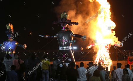 Effigies of demon king Ravana (C), Meghnath (L) and Kumbhakarana burn during the Dussehra festival celebrations in New Delhi, India, 15 October 2021. Limited people were allowed inside the Dussehra festival celebration area due to Indian government guidelines over the Covid-19 pandemic. Dussehra is an annual Hindu religious festival, which follows the nine-day festival of Navratri and marks the victory of the Hindu God Lord Rama over the evil demon king Ravana.